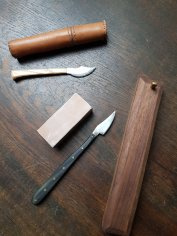 Leather case made by my father, knife to the left made by Felrick, sharpener, knife and wood case made by John